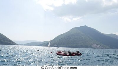 Yachts, boats, ships in the Bay of Kotor, Adriatic Sea,...