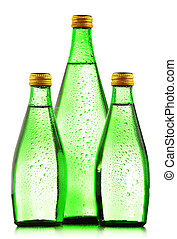 Glass bottles of mineral water isolated on white