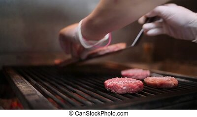 Burger cutlets roasted on a grill.