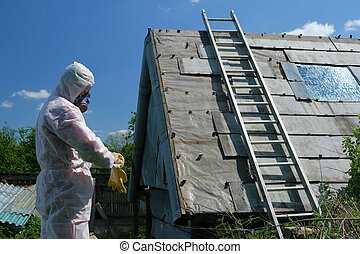 Asbestos disposal - Asbestos removal worker. Dangerous waste...