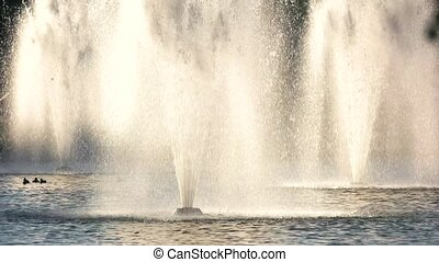 Fountains in motion. Water spalshes outdoor.