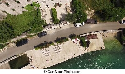 Wedding on the quay in Kotor Bay, Montenegro. Aerial...