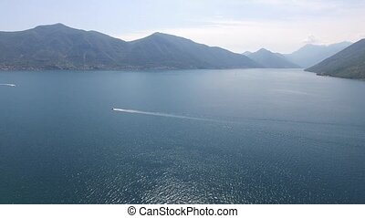 Boat in the Bay of Kotor. Montenegro, the water of the...
