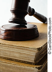 Close up of Wooden Gavel on Old Stack of Books - Close up...