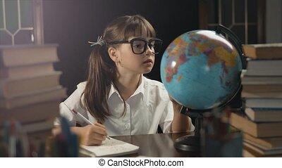 Smart Schoolgirl Use Globe - Eight years school girl wears...