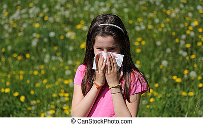 Child with long brown hair with allergy to the pollen blows...