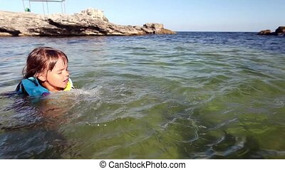 Child learn to swim