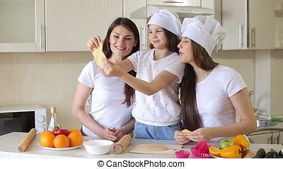Family at Home in Kitchen Having a Good Time.