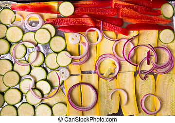 veggies - Rings and Slices of Raw vegetables on a pan