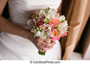 Bride holding bridal bouquet close up. pink and white roses,...