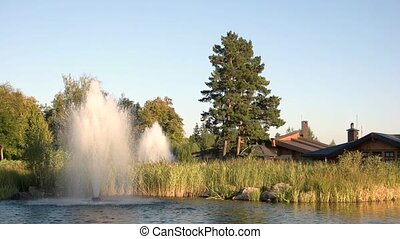 Pond with fountains and houses. Nature and sky. Build a...