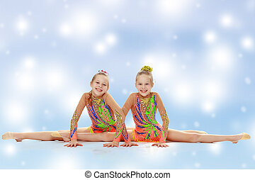 Two girls gymnast sitting on splits. - Two adorable little...