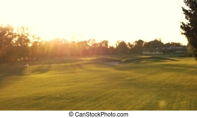 Blurry golf field. Grass and sun. Vacation destinations for...