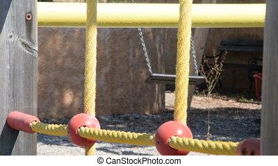 Empty swing in the backyard of kindergarten