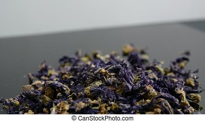 Dry herbs and flowers for herbal infusion falling and...