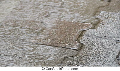 Rain falling on the walkway