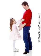 Little girl pulls her hands to his daddy.