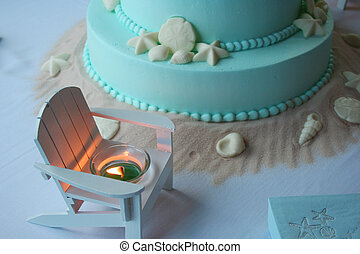 Beach themed wedding cake with lit - Beach themed aqua...
