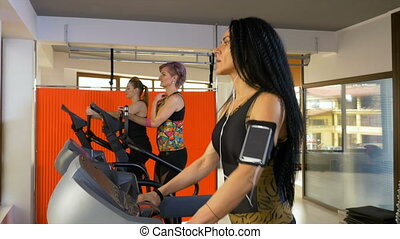 Fitness woman with smartphone arm strap listening to music...