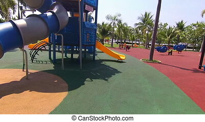 Walk to the playground in public park at sunny day.
