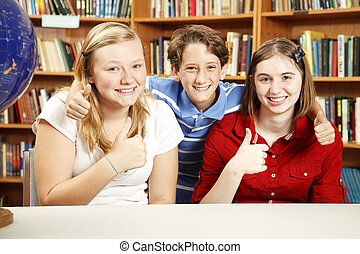 Thumbs Up for Education - Three school kids in the library,...