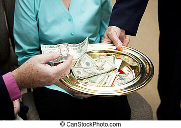 Passing Collection Plate - Church members putting money in...