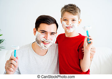 Father and son shaving - Father teaching his son to shave...