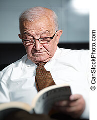 old man reading a book - portrait of old man reading a book