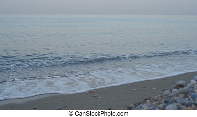 Waves on the beach, sunrise