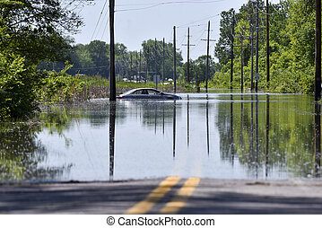 Stranded car - A car stalled and stranded on a flooded road