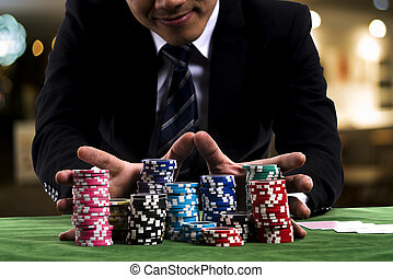 A poker Player used hands pushing in all his chips to...