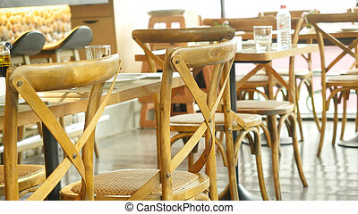 Served tables in a restaurant - Empty served tables in a...