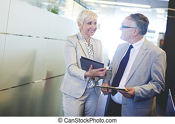 Business couple with work tools