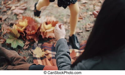 cute little girl come running into the arms to her beautiful...