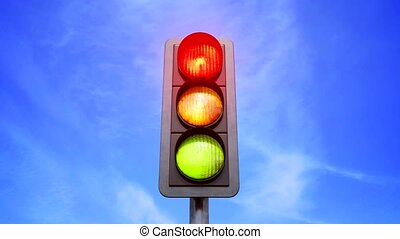 Traffic light color change from red in yellow and green -...
