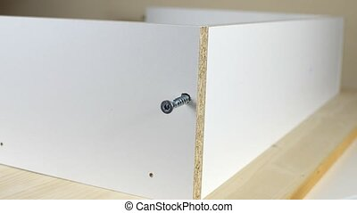 Screwing with Allen Key - Fastening two particle boards with...