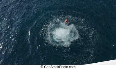A guy jumps from a yacht moored near Budva, Montenegro.