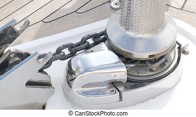 Anchoring system on the yacht. The thick chain lifts the anchor.