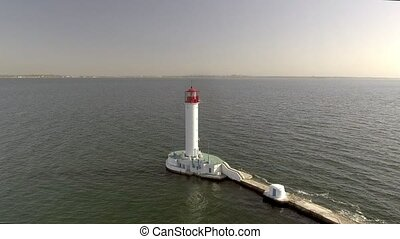 Aerial view of white lighthouse. Sea Port of Odessa....