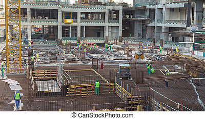 Modern building constraction site works. - Laborers working...