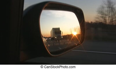 Side mirror sunset.