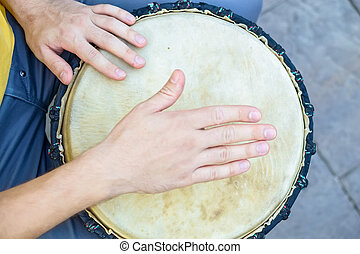 Top view hand of bongo player - Tom view male hand playing...