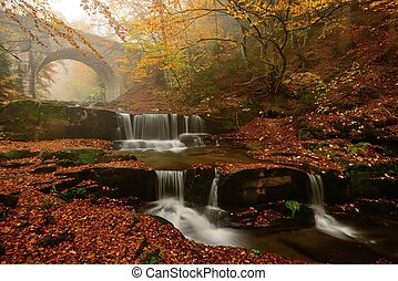Autum colors, waterfalls and bridge in Rodopi mountain,...