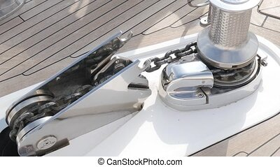 Anchoring system on the yacht. The thick chain lifts the...