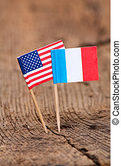 Flags of France and USA on wooden background
