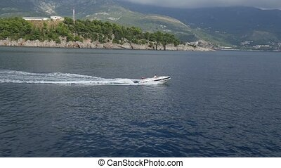 The boat in the sea near Budva. Montenegro, Budva Riviera,...