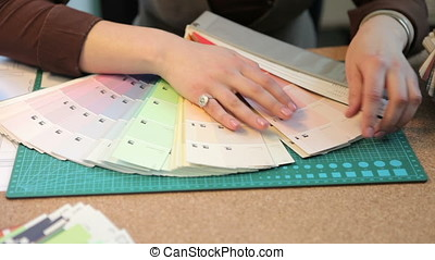 Close up of architect choosing colors from color pallet at...