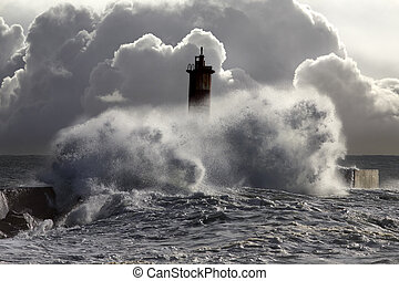 Stormy waves against beacon