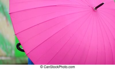 young woman with umbrella smiling