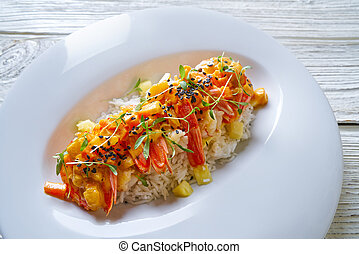 Seafood red curry with shrimps prawns sprouts and sesame...